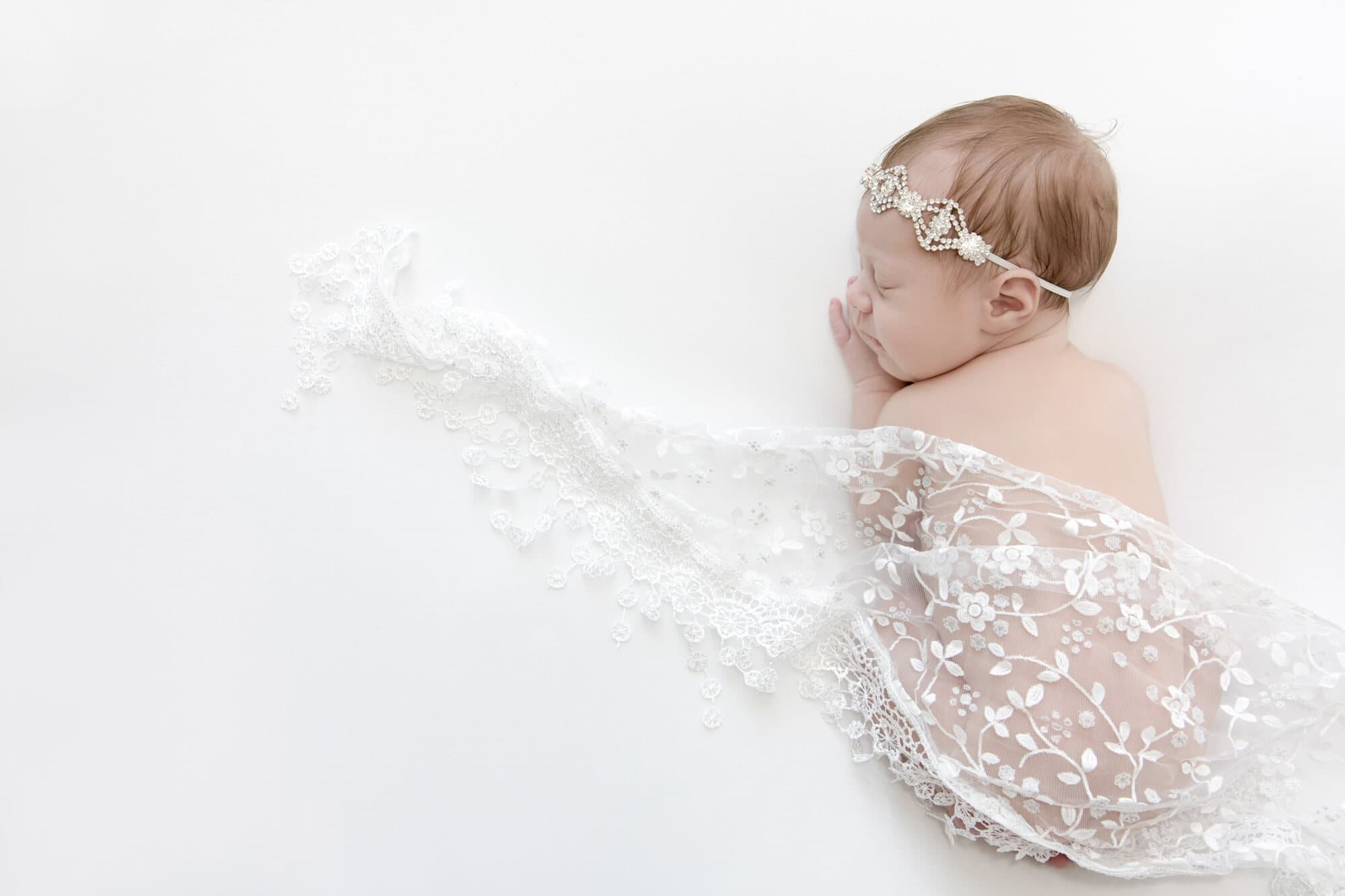 newbornn portrait photograph baby girl in white lace wrap