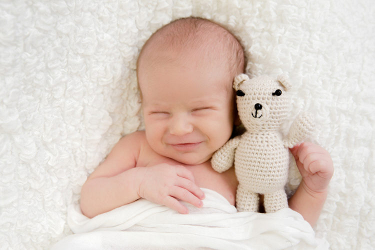 laughing newborn baby portrait