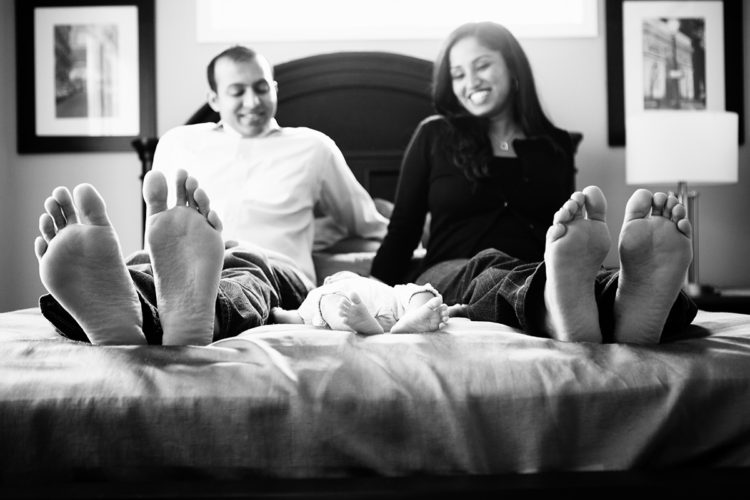 newborn baby feet photoshoot on the bed
