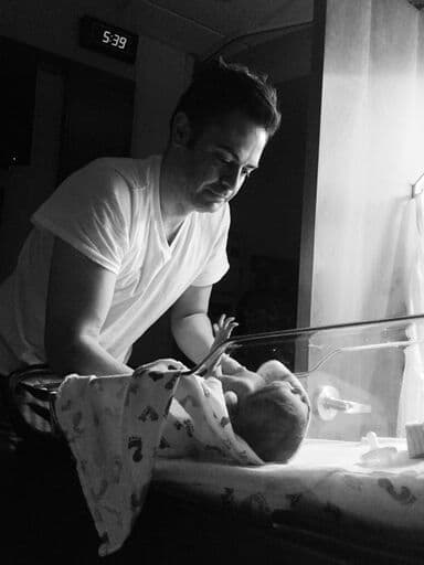 black and white iphone photo newborn and dad in hospital