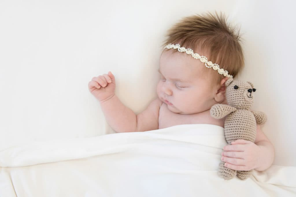 newborn baby studio photography with teddy bear